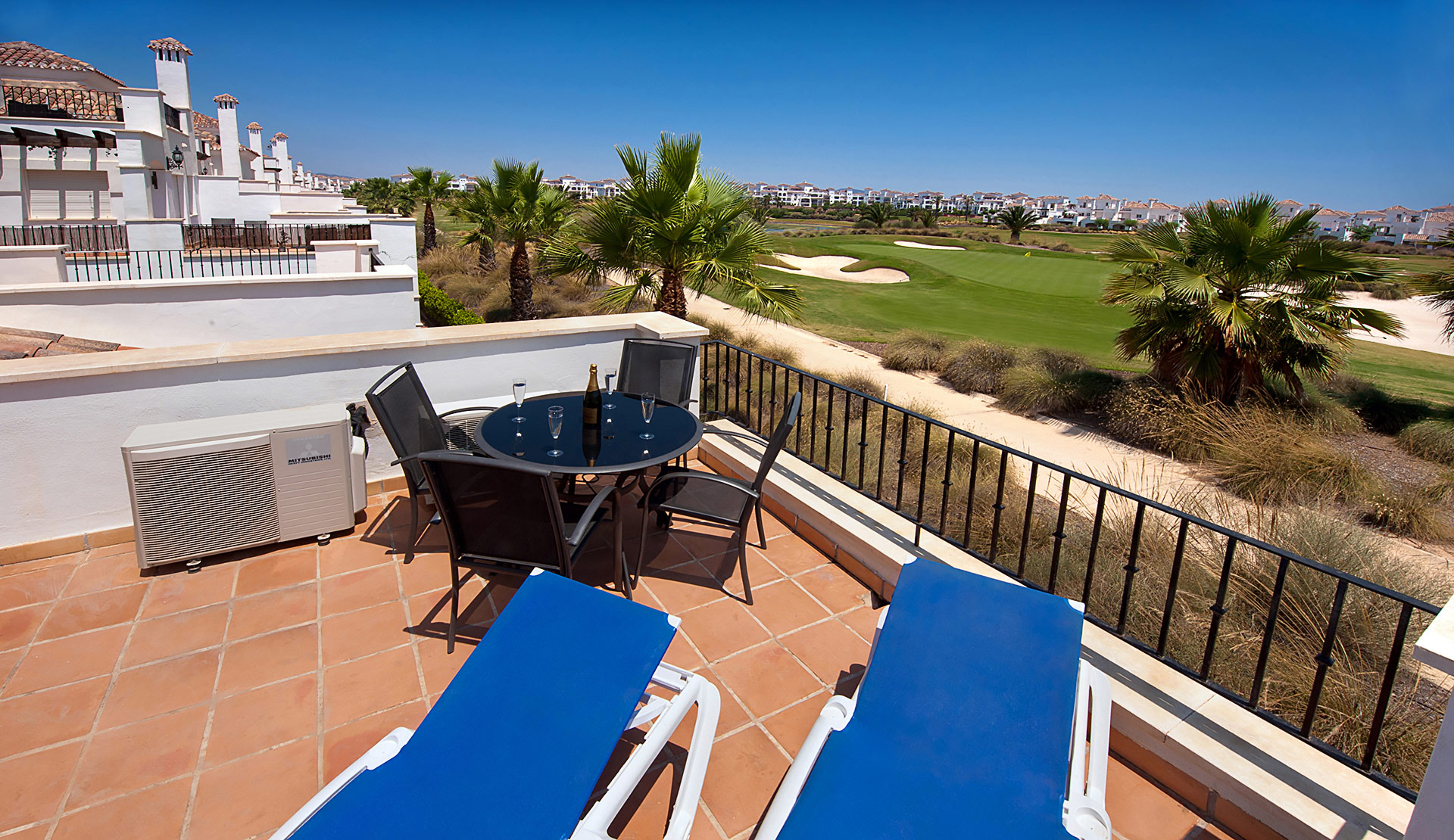 Holiday rental in Murcia, Spain. The terrace, overlooking the golf course at La Torre Golf Resort.